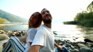 Young couple taking selfies outdoors video