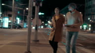 Young couple using pad to find the way in big city video