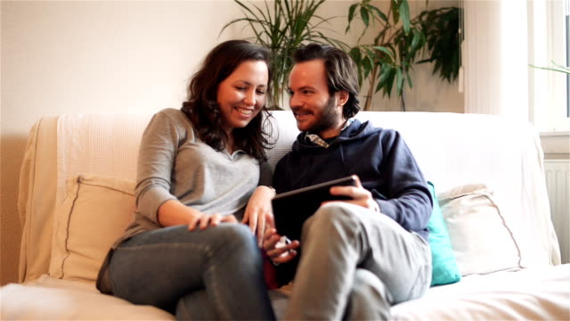 DOLLY: Young couple video chatting with tablet computer video