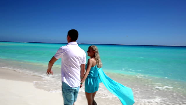 Young couple walking  on beach video