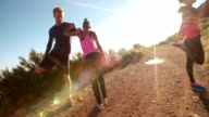 Young couple warming up before running outdoors video
