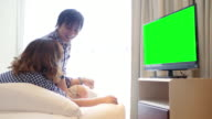 4K : Young Couple Watch Chromakey TV video