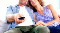 Young couple watching TV video