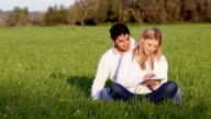 young couple with digital tablet an head phones video