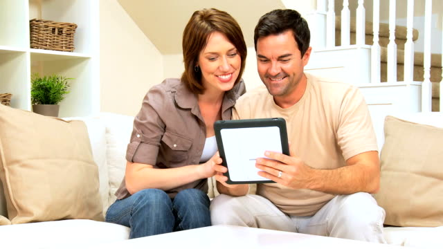 Young Couple With Wireless Tablet at Home video