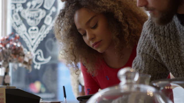 Young Couple Working In Coffee Shop Shot On R3D video