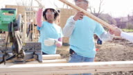 Young couple working together on home being built for charity video