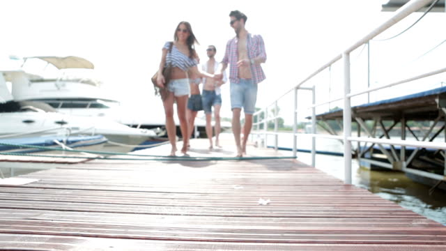 HD: Young couples going on yacht. video