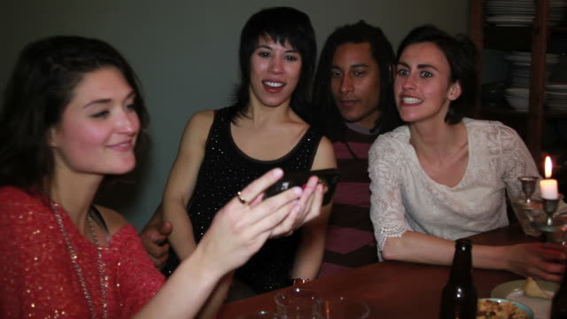 Young couples having a party, drinking and eating video