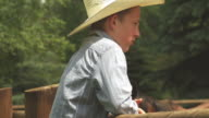 Young cowboy looks out over the farm video