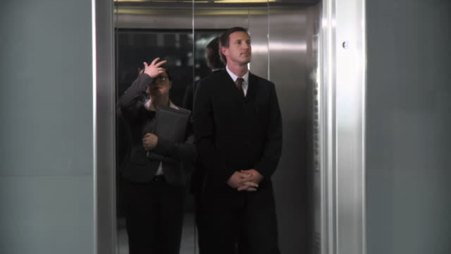 HD: Young Co-Workers Making Love In Elevator video