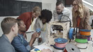 4K: Young Creative People Working By 3D Printer. video