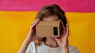 Young curly woman using Virtual Reality Glasses video