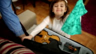 Young cute girl with violin at home video