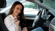 Young Cute Happy Woman Showing Car Keys After Getting Drivers License. Beautiful Young Driving Student Starts The Car At The First Time video