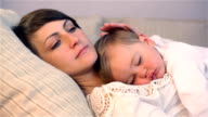 Young cute little boy sleeping with mum video