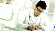 Young Doctor Writing Handing RX Prescription Focus Change video