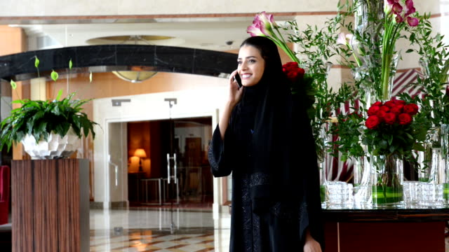 Young Emirati woman by the red roses video