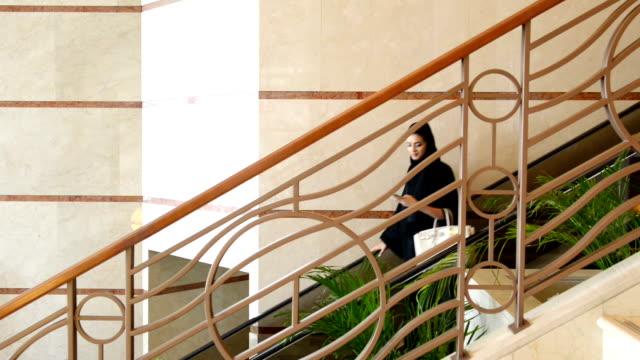 Young Emirati woman on the escalator video