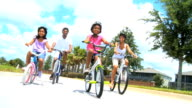 Young Ethnic Family Enjoying Cycling Together video