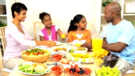 Young Ethnic Family Sharing a Healthy Lunch video