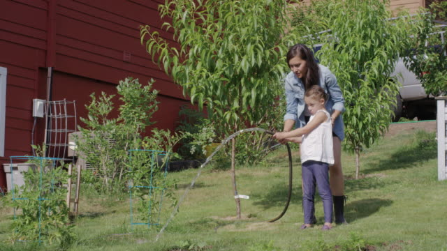 Young ethnic mother gardening with her daughter video