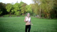 Young excited athletic woman jumping with joy, slow motion video