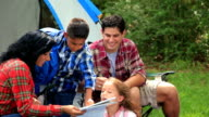 Young family camping outdoors in tent.  National forest. Woods. video