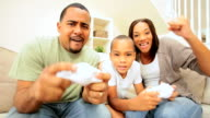 Young Family Competing on a Games Console video