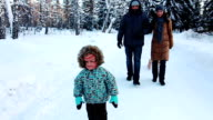 Young Family is walking in Winter Park. video