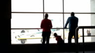 Young family watching planes at an airport video