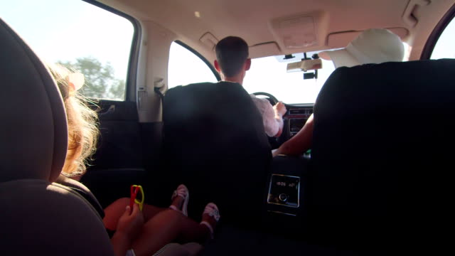 Young family with little daughter traveling by car on summer vacation video