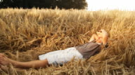 HD: Young Farmer Resting In Wheat video