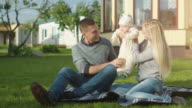 Young Father and Mother Play with Their Baby. video
