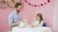 Young father having a tea party with his adorable daughter video