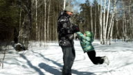 Young father is spinning his son around in winter video