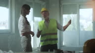 Young female architects and senior construction worker video