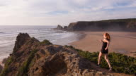 Female Athlete Running by the Ocean video