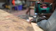 Young female carpenter cutting wood video