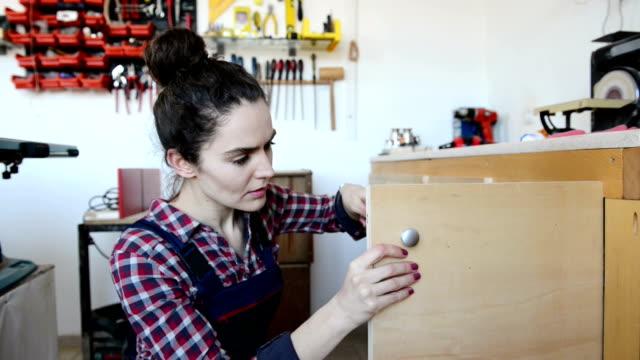 Young female carpenter video