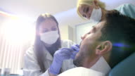 Young female dentist working video