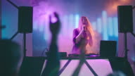 Young Female DJ Singing in Nightclub video