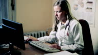 Young Female Doctor working in the office video