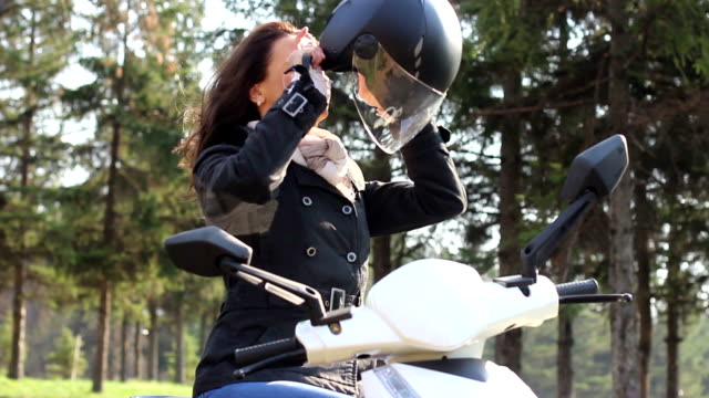 Young female enjoys a motorcycle ride HD VIDEO video