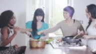 Young female friends in the kitchen video
