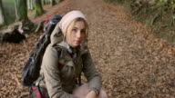 Young female hiker taking a breath video