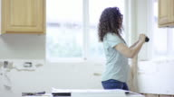 Young female homeowner working on diy project at home video