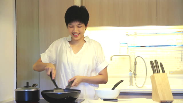 HD : Young Female is cooking in kitchen video