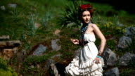 Young female model in mexican dress posing outdoor video