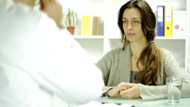 Young Female Patient Accpeting Prescription at Doctor Office video